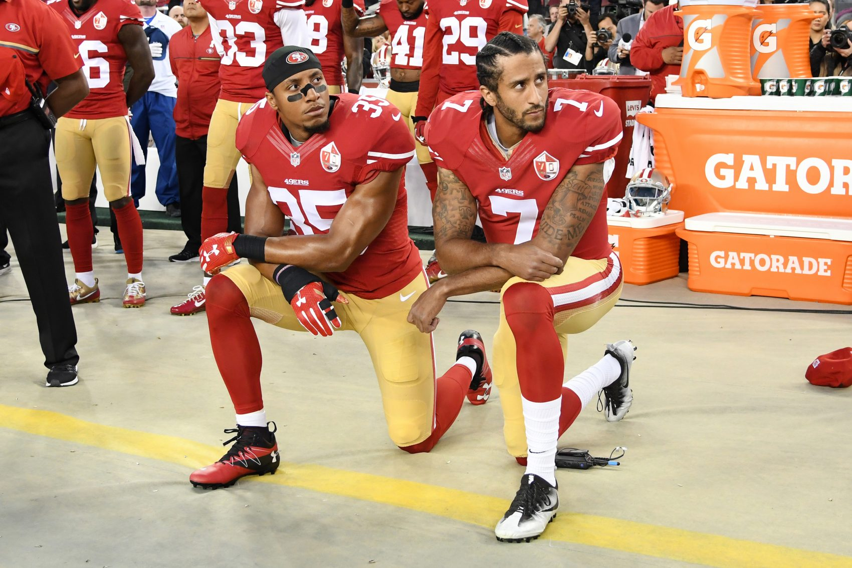 """""""But then a big change happened -- didn't seem like much, but by my estimation, changed everything. Instead of sitting, Kaepernick kneeled."""" (Thearon W. Henderson/Getty Images)"""
