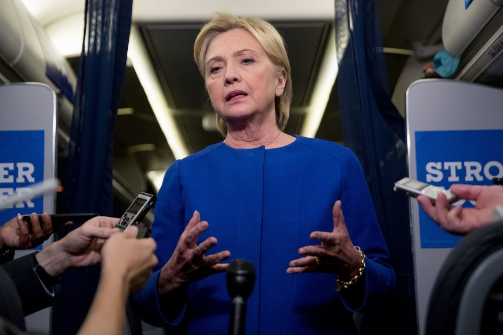 Democratic presidential candidate Hillary Clinton gives remarks on the explosion in Manhattan's Chelsea neighborhood onboard her campaign plane at Westchester County Airport, in White Plains, N.Y., Saturday, Sept. 17, 2016. (Andrew Harnik/AP)