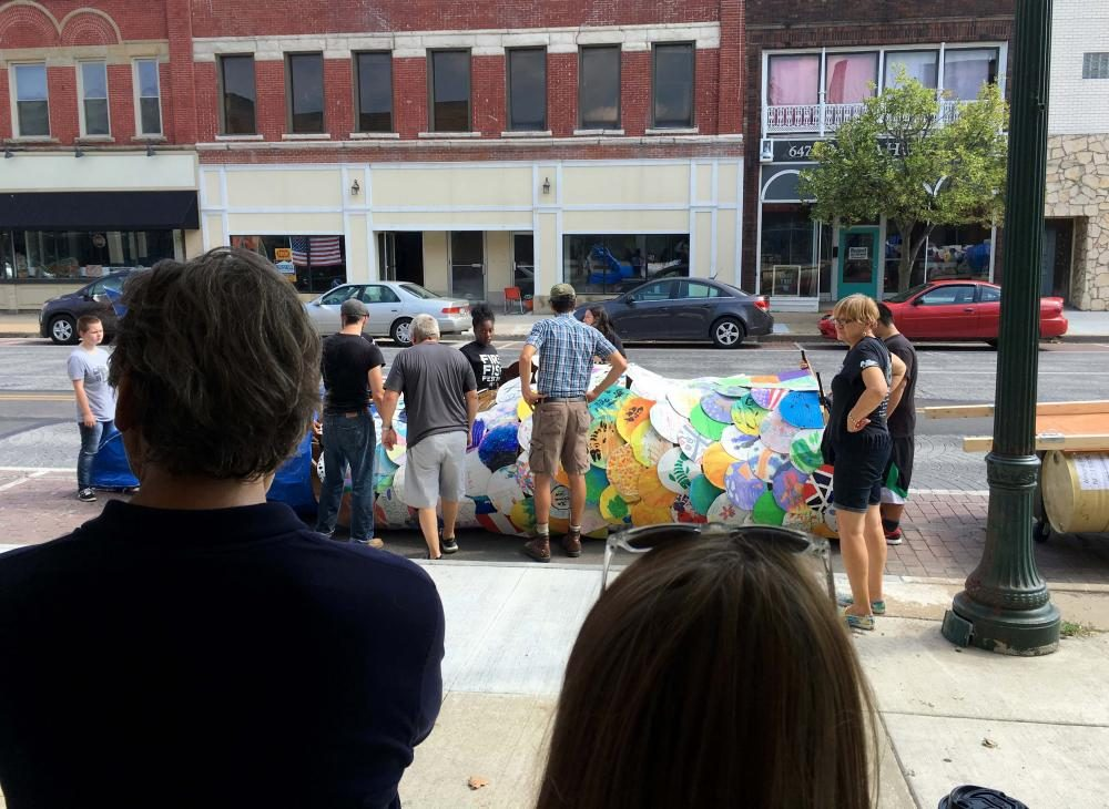 Volunteers prepare FireFish on a Saturday afternoon in Downtown Lorain, Ohio. (Matt Richmond/WCPN)
