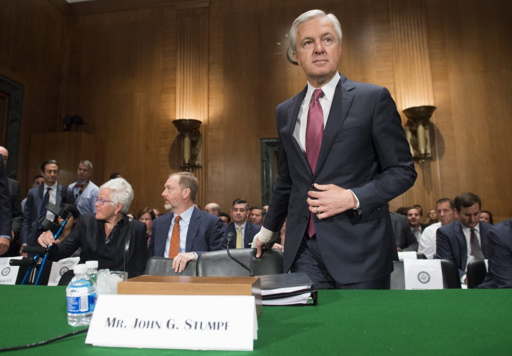 John Stumpf, chairman and CEO of Wells Fargo, arrives to testify about the unauthorized opening of accounts by Wells Fargo during a Senate Banking, Housing and Urban Affairs Committee hearing on Capitol Hill in Washington, D.C., Sept. 20, 2016. (Saul Loeb/AFP/Getty Images)