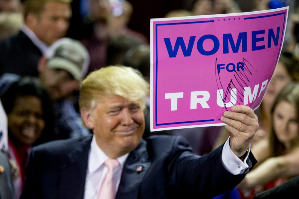 "Republican presidential candidate Donald Trump holds up a sign that reads ""Women for Trump"" after speaking at a rally at Valdosta State University in Valdosta, Ga., Feb. 29, 2016. (Andrew Harnik/AP)"