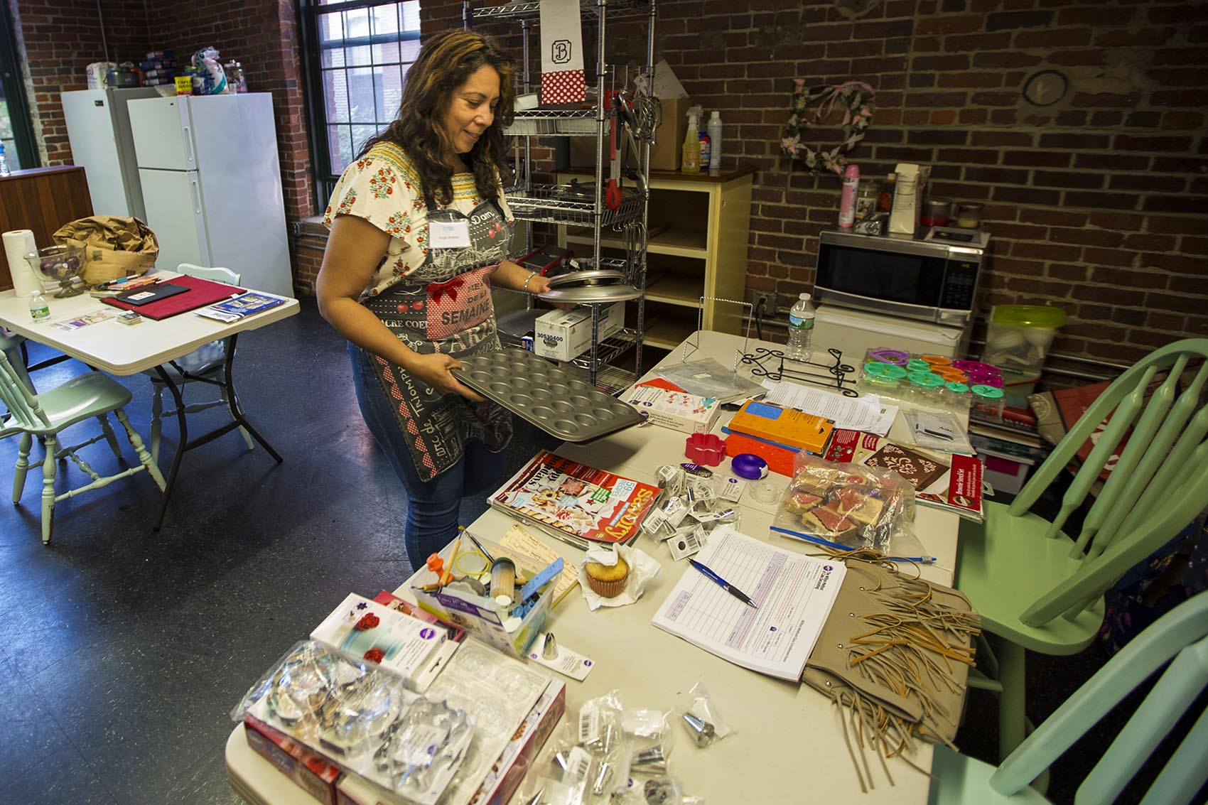 Angie Jimenez is a graduate of Entrepreneurship for All, a business accelerator program in Lawrence. She's starting a cooking school in a renovated mill building in the city. (Jesse Costa/WBUR)