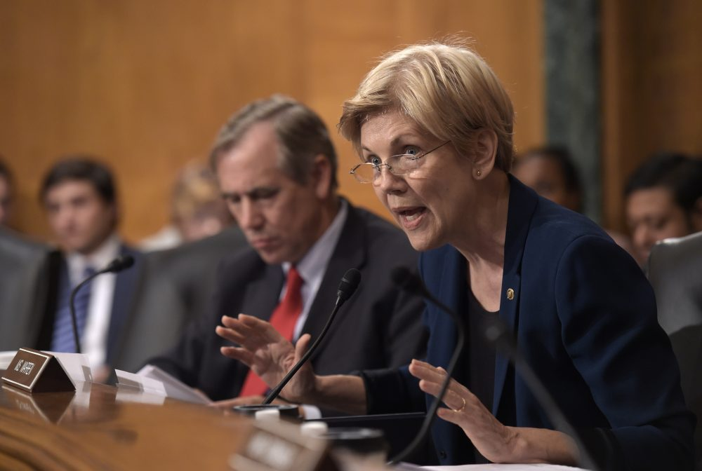 Senate Banking Committee member Sen. Elizabeth Warren, D-Mass., questions Wells Fargo Chief Executive Officer John Stumpf, on Capitol Hill in Washington, Tuesday. (Susan Walsh/AP)