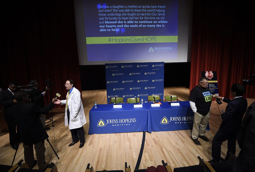 Dorry Segev, left, and Morris Murray, previous liver transplant recipient, are interviewed about the first ever HIV-positive liver transplant in the world after a news conference at Johns Hopkins hospital, March 30, 2016 in Baltimore. (Gail Burton/AP)