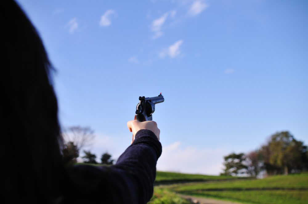 The Northeastern/Harvard  survey found that women were more likely to own a gun for self-defense than men. (Ajari/Flickr)