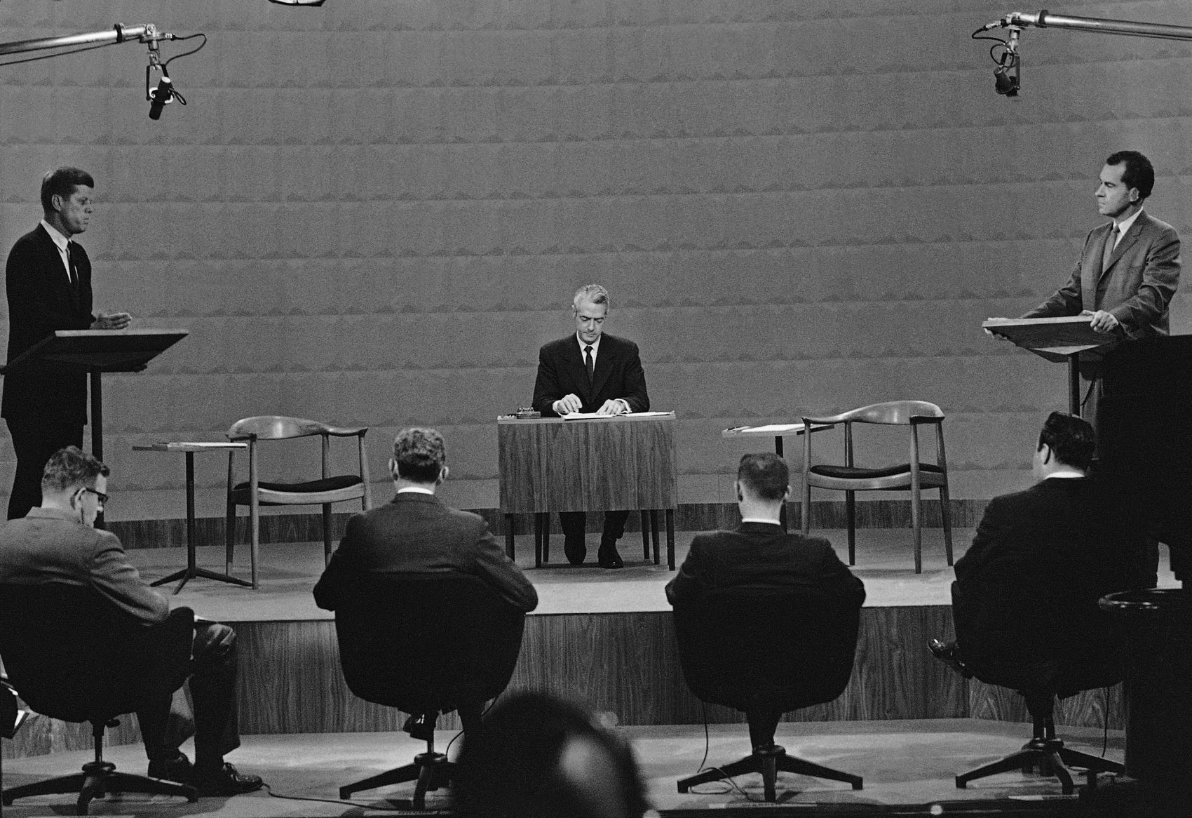 Presidential candidates Sen. John Kennedy, left, and Vice President Richard Nixon face each other in a Chicago television studio during the first-ever televised presidential debate on Sept. 26, 1960. In center is moderator Howard K. Smith. (AP)