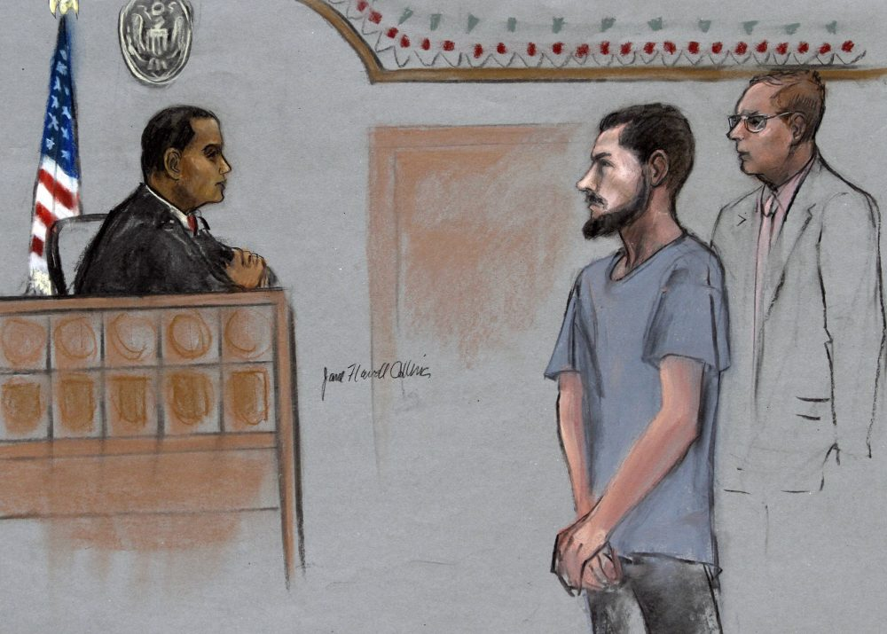 In this June 12, 2015, file courtroom sketch, Nicholas Rovinski, of Warwick, Rhode Island, is depicted standing with his attorney during a hearing in federal court in Boston. (Jane Flavell Collins via AP)