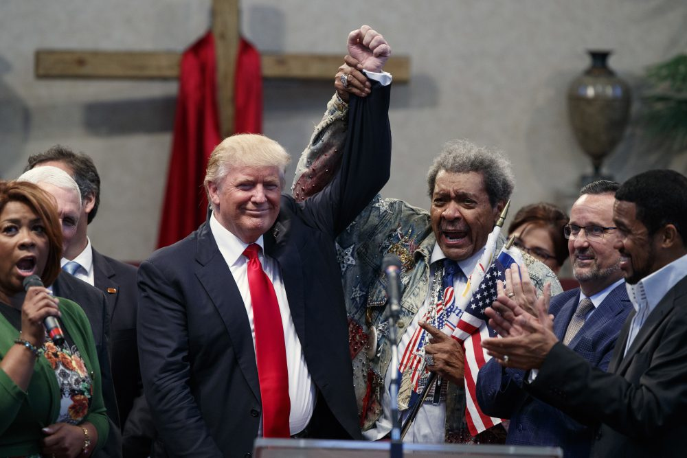 Boxing promoter Don King, right, holds up the hand of Republican presidential candidate Donald Trump during a visit to the Pastors Leadership Conference at New Spirit Revival Center, Wednesday, Sept. 21, 2016, in Cleveland, Ohio. (Evan Vucci/AP)