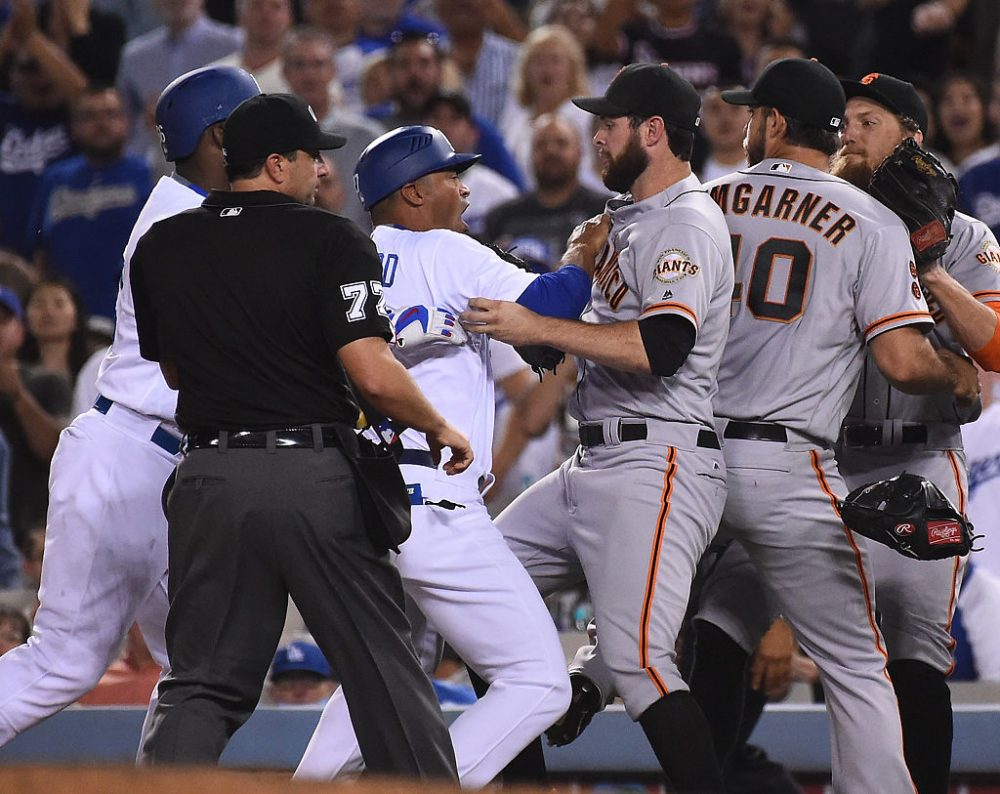 """Giants pitcher Madison Bumgarner started a bench-clearing brawl on Monday night by repeatedly screaming at Yasiel Puig of the Dodgers for looking at him. The Dodgers responded by showed up on Twitter in T-shirts reading """"Don't Look At Me."""" (Jayne Kamin-Oncea/Getty Images)"""