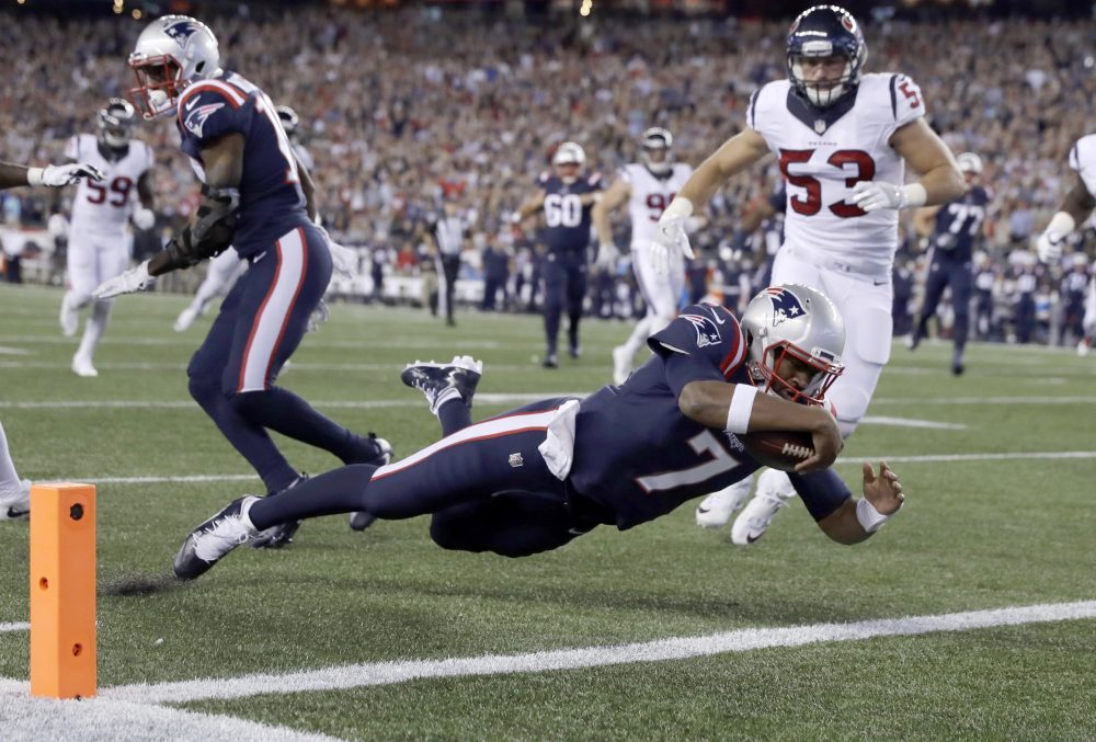 Quarterback Jacoby Brissett of the New England Patriots runs for a touchdown during a game against the Houston Texans on Thursday night. (Charles Krupa/AP)