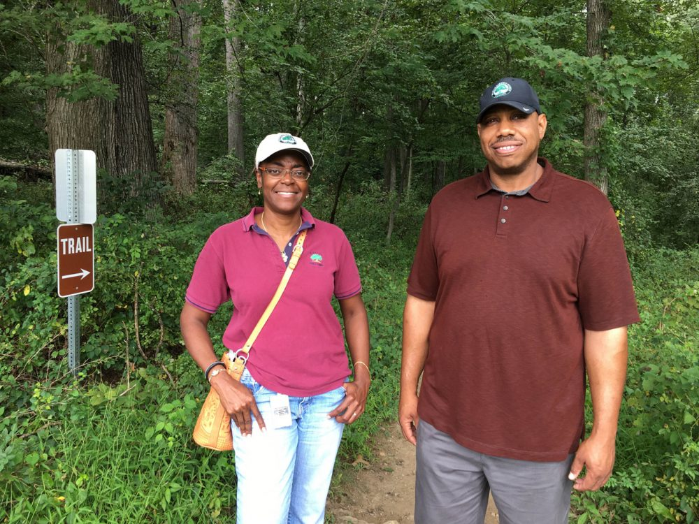 Shirl Spicer and Mark Thorne of the Woodlawn Manor Cultural Park walk a route trafficked by the Underground Railroad. (Martin Di Caro/WAMU)