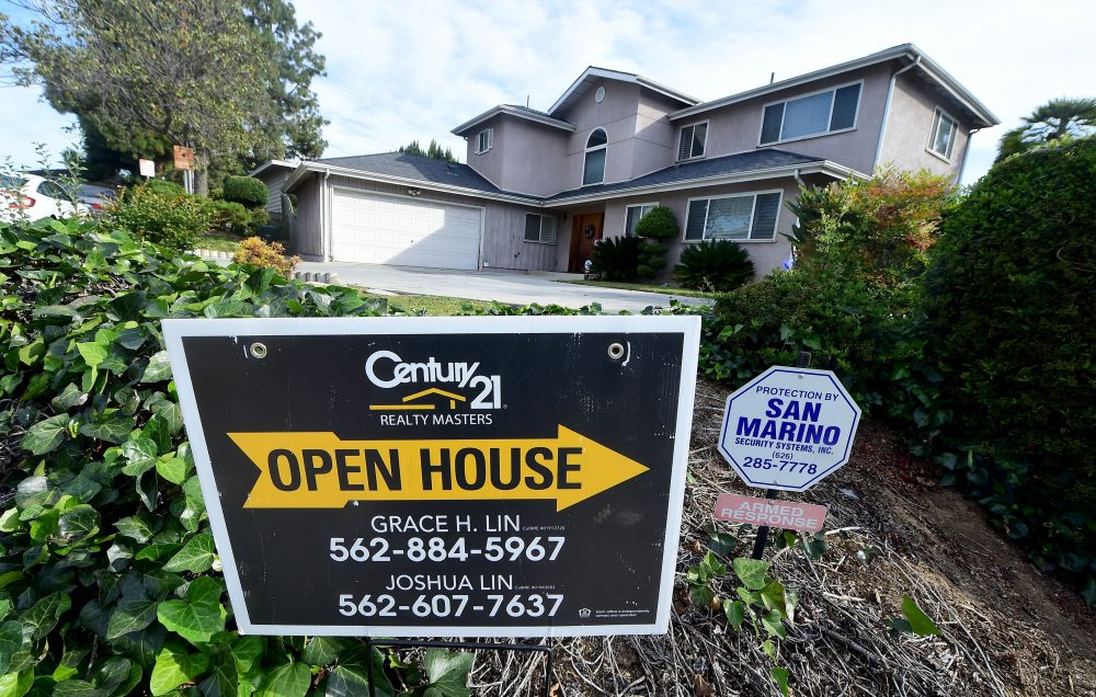 An open house sign directs prospective buyers to a property for sale in Monterey Park, Calif., on April 19, 2016. (Frederic J. Brown/AFP/Getty Images)
