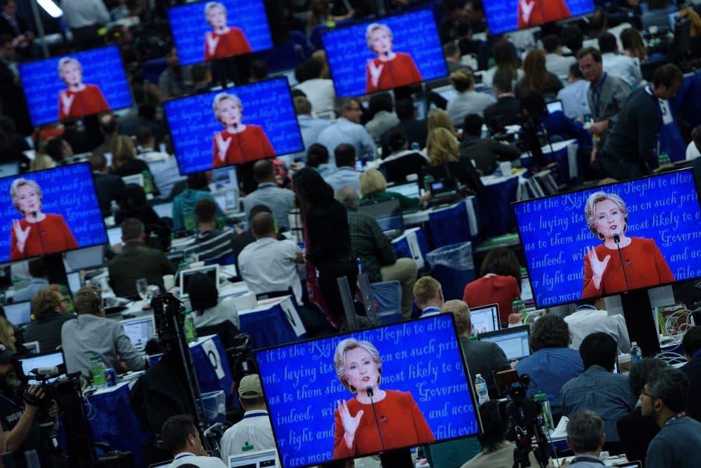 Democratic presidential nominee Hillary Clinton is seen on multiple screens speaking during the first presidential debate at Hofstra University on Sept. 26, 2016, in Hempstead, N.Y. (Brendan Smialowski/AFP/Getty Images)