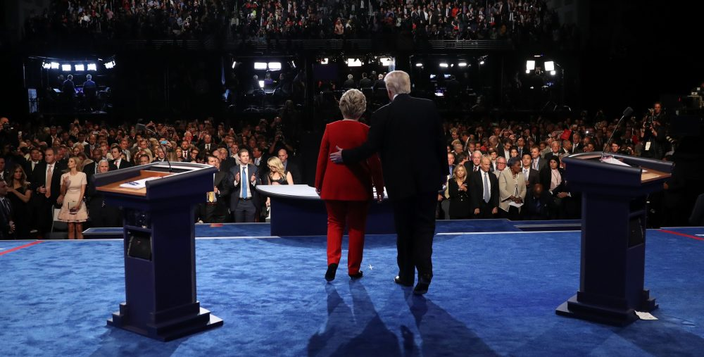 Democratic nominee Hillary Clinton (left) and Republican nominee Donald Trump greet the audience at the end of the first presidential debate at Hofstra University in Hempstead, New York on Sept. 26, 2016. (Joe Raedle/AFP/Getty Images)