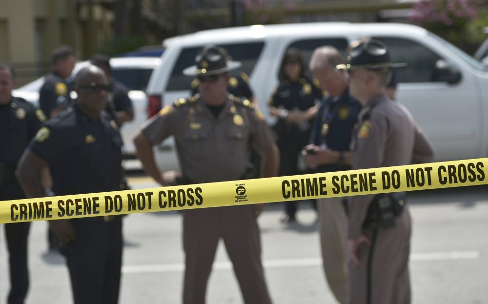Police stand behind a crime scene tape near the mass shooting at the Pulse nightclub on in Orlando, Florida on June 12, 2016. The murder rate in the U.S. rose 10.8 percent last year, according to new data from the FBI. (Mandel Ngan/AFP/Getty Images)