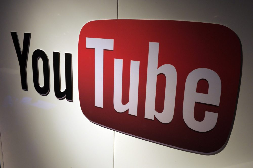 Some YouTube filmmakers say the way the company shares its ad revenue is problematic. (Eric Piermont/Getty Images)