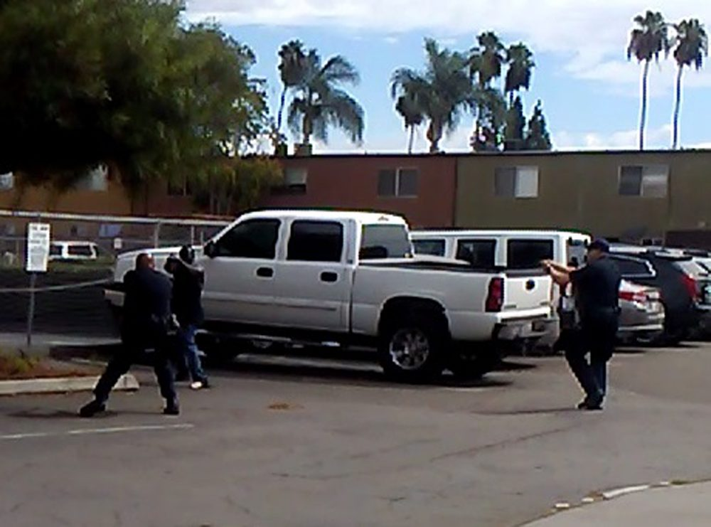El Cajon police provided this image, which they say is a still from a bystander cell phone video of the shooting of an unarmed black man on Tuesday. (El Cajon Police Department)