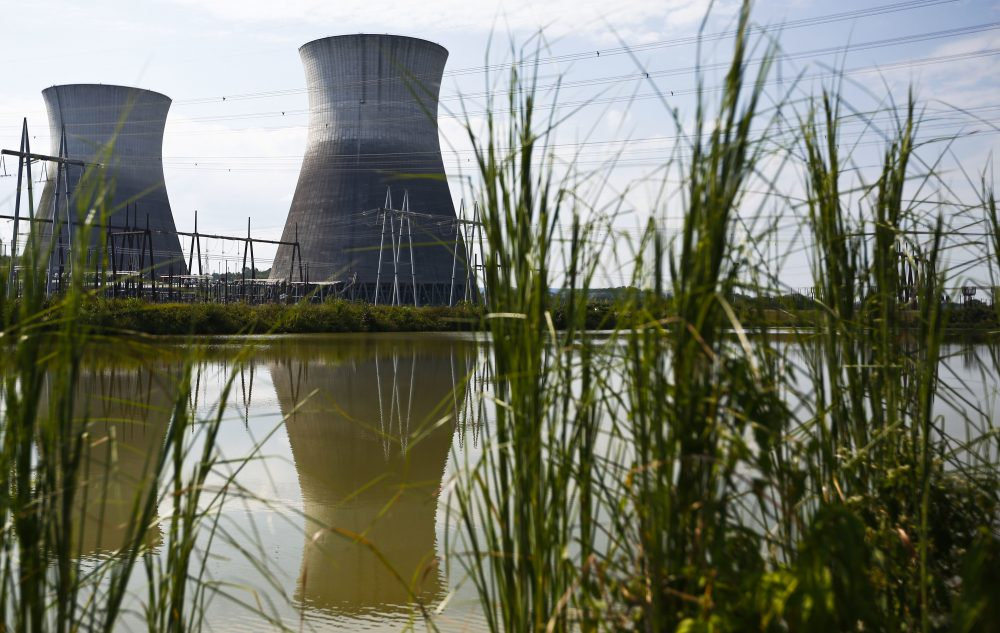 Two cooling towers can be seen in the reflection of a pond outside of the Bellefonte Nuclear Plant, in Hollywood, Ala. The Tennessee Valley Authority has set a minimum bid of $36.4 million for its unfinished Bellefonte Nuclear Plant and the 1,600 surrounding acres of waterfront property on the Tennessee River. (Brynn Anderson/AP)