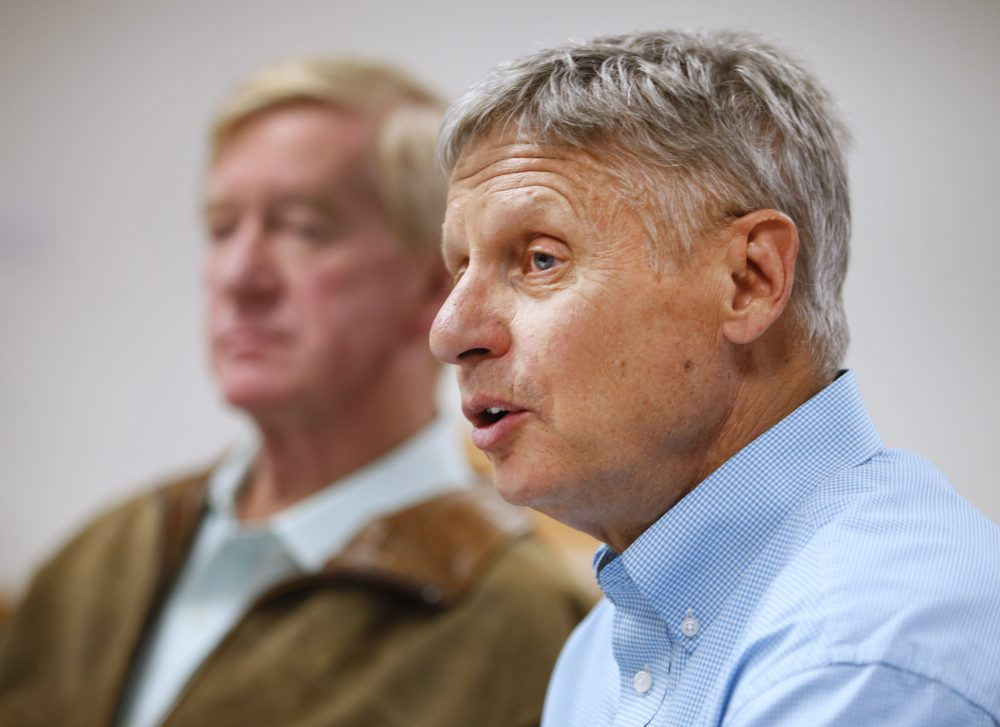 Libertarian presidential candidate Gary Johnson (R), and his running mate Bill Weld (L), talk to the press before a rally on Aug. 6, 2015 in Salt Lake City. (George Frey/Getty Images)