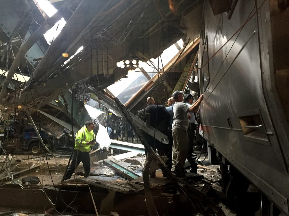 Train personnel survey the NJ Transit train that crashed in to the platform at the Hoboken Terminal on Sept. 29, 2016, in Hoboken, N.J. (Pancho Bernasconi/Getty Images)