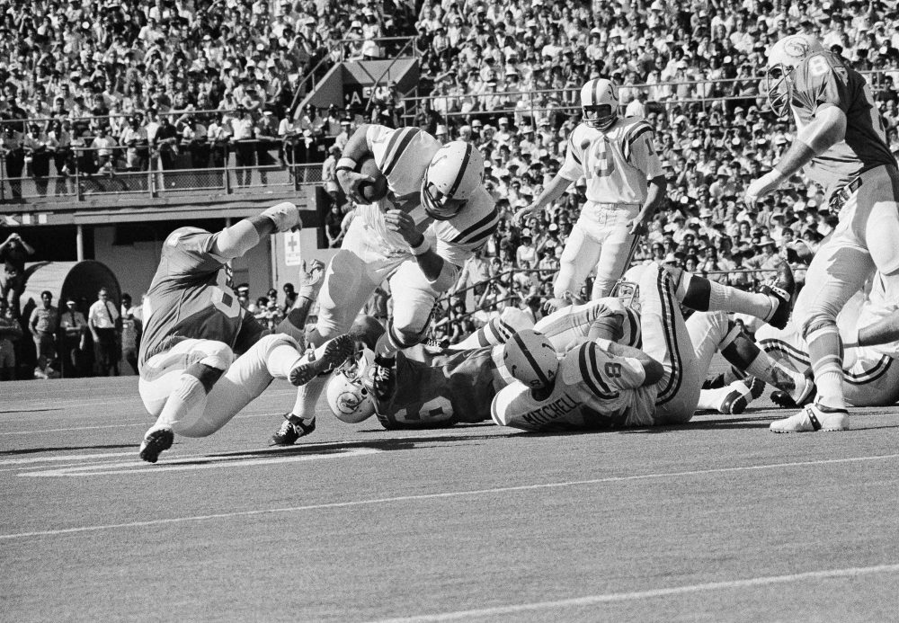 For most of his 12-year career, Tom Matte of the Baltimore Colts played running back. But for three games in 1965, he had to take on a new position. (AP)