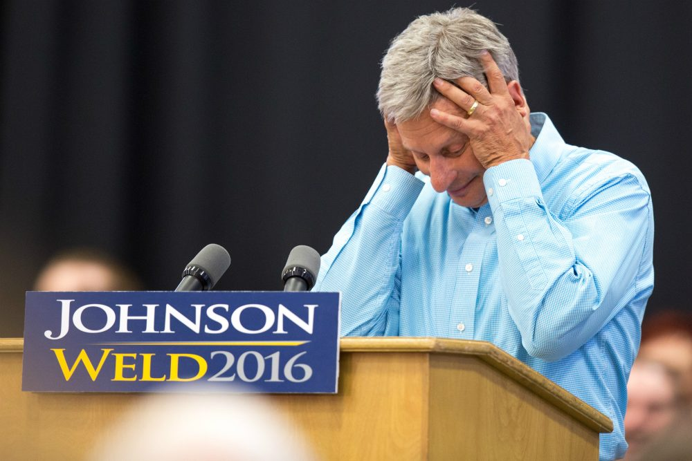 Libertarian presidential candidate Gary Johnson reacts as his microphone stops working during a campaign rally, Saturday, Sept. 3, 2016, at Grand View University in Des Moines, Iowa. (Scott Morgan/AP)