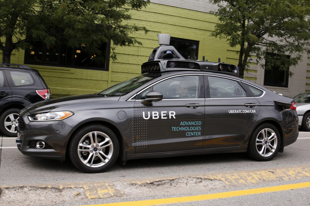 A self driving Uber car drives in Pittsburgh on Wednesday, Sept. 14, 2016. While the vehicles are loaded with features that allow them to navigate on their own, an Uber engineer sits in the driver's seat and can seize control if things go awry. (Gene J. Puskar/AP)
