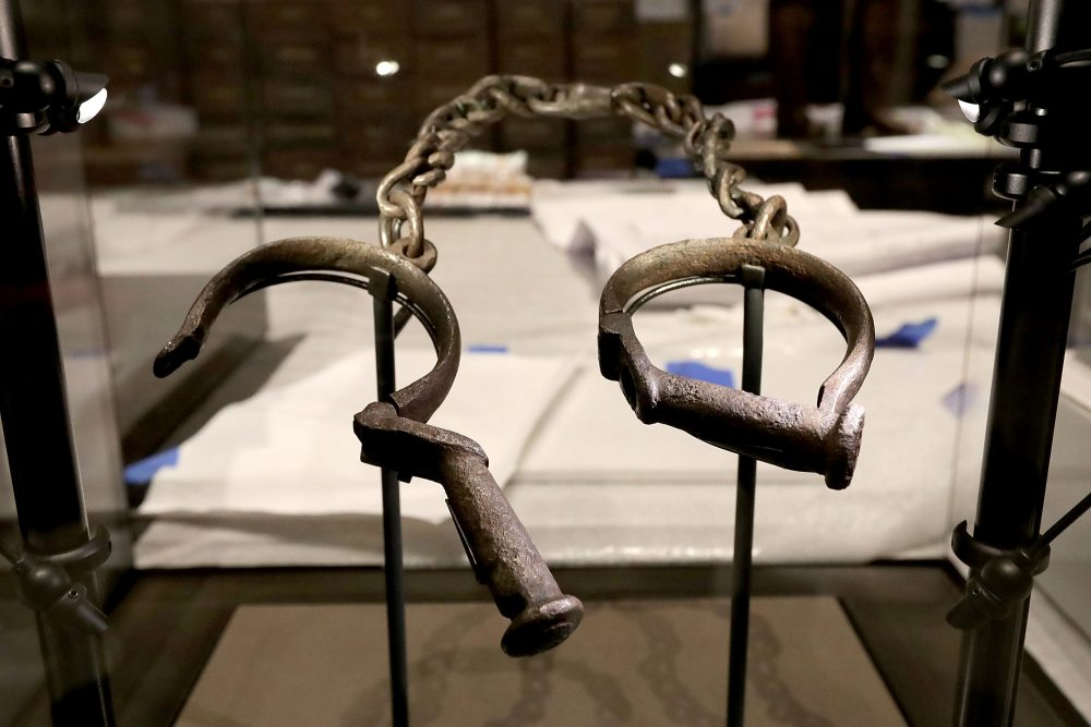 A pair of slave shackles on display in the Slavery and Freedom Gallery in the Smithsonian's National Museum of African American History and Culture on Sept. 14, 2016, in Washington. (Chip Somodevilla/Getty Images)