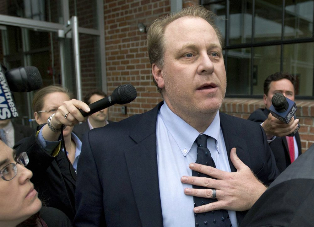 In this 2012 file photo, former Sox pitcher Curt Schilling is followed by members of the media as he departs the Rhode Island Economic Development Corporation headquarters in Providence. (Steven Senne/AP)