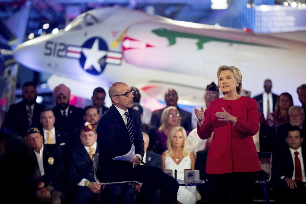"""Democratic presidential candidate Hillary Clinton, with """"Today"""" show co-anchor Matt Lauer, left, speaks at the NBC Commander-In-Chief Forum held at the Intrepid Sea, Air and Space museum in New York on Wednesday, Sept. 7, 2016. (Andrew Harnik/AP)"""