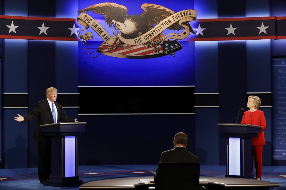 Donald Trump and Hillary Clinton are seen on stage during the first presidential debate Monday night in New York. (David Goldman/AP)