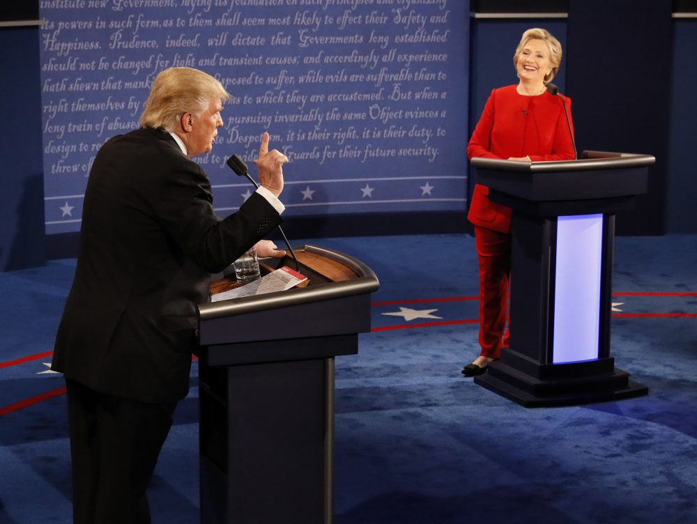 A new WBUR poll of likely New Hampshire voters finds they believe Hillary Clinton won Monday's presidential debate against Donald Trump. (Rick T. Wilking/Pool/AP)