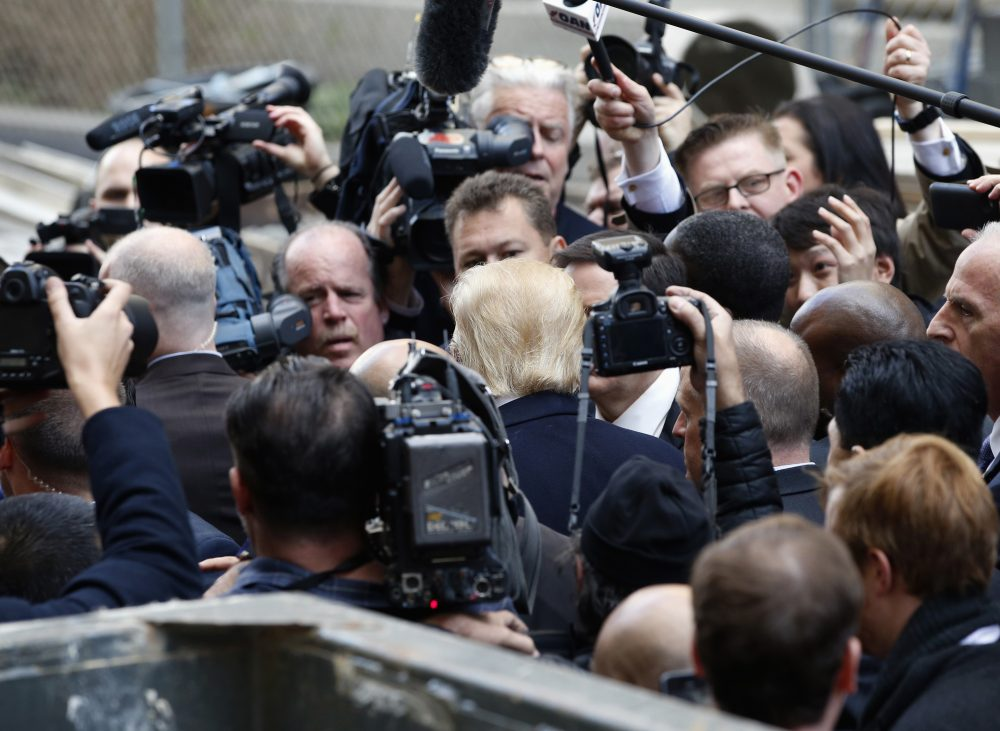 Republican presidential candidate Donald Trump, center, is surrounded by the media in Washington, Monday, March 21, 2016. (Alex Brandon/AP)
