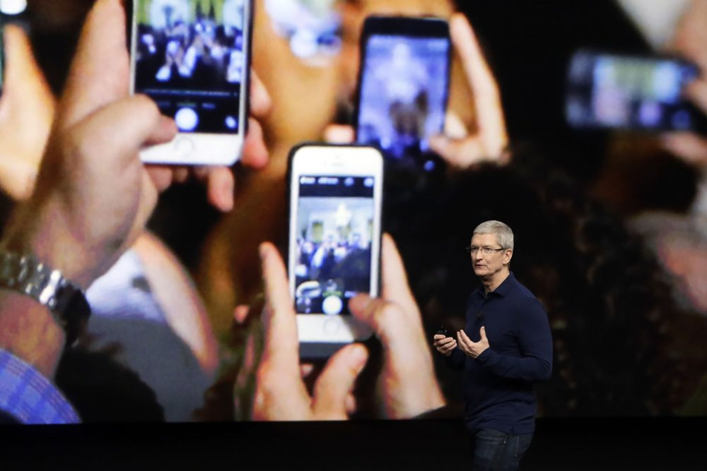 Apple CEO Tim Cook announces the new iPhone 7 during an event to announce new products Wednesday, Sept. 7, 2016, in San Francisco. (Marcio Jose Sanchez/AP)