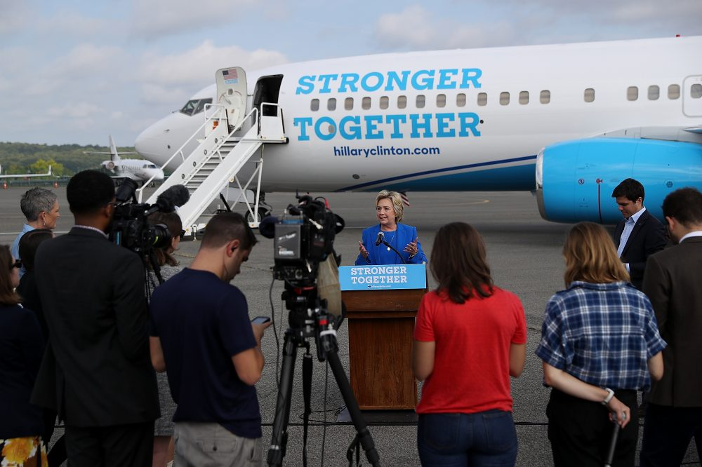 Democratic presidential nominee Hillary Clinton speaks to reporters on the tarmac at Westchester County Airport on Sept. 8, 2016 in White Plains, New York, before leaving for North Carolina and Missouri to campaign. (Justin Sullivan/Getty Images)