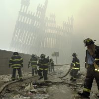 After 9/11, two years and 23 suicide attacks in Israel left author Alison Murphy inured to the frequency of terror strikes. Now she wonders, can she get unused to such them? Pictured: Firefighters work beneath the destroyed mullions, the vertical struts which once faced the soaring outer walls of the World Trade Center towers, after a terrorist attack on the twin towers in New York on September 11, 2001. (Mark Lennihan/AP)