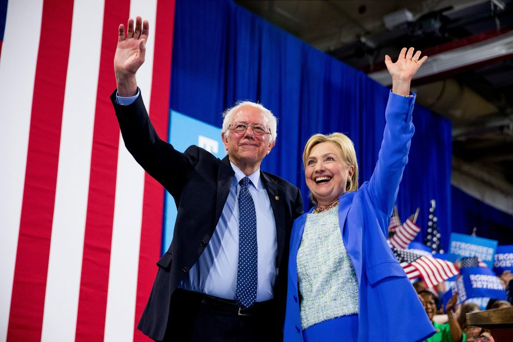 Former rivals Bernie Sanders and Hillary Clinton in July 2016. (Andrew Harnik/AP file)