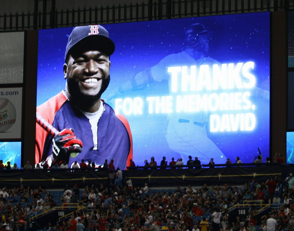 A video of Boston Red Sox's David Ortiz is shown on a television during the second inning of a baseball game against Tampa Bay Rays Sunday, Sept. 25, 2016, in St. Petersburg, Fla. Ortiz asked the Tampa Bay Rays to cancel a pregame tribute they planned in his honor, after the death of Miami Marlins pitcher Jose Fernandez in a boating accident Sunday.(AP Photo/Luis M. Alvarez)