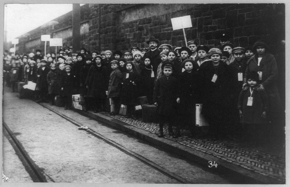 Children stand on the sidewalk in Lawrence, Mass. during the Bread and Roses strike of 1912. (Library of Congress)