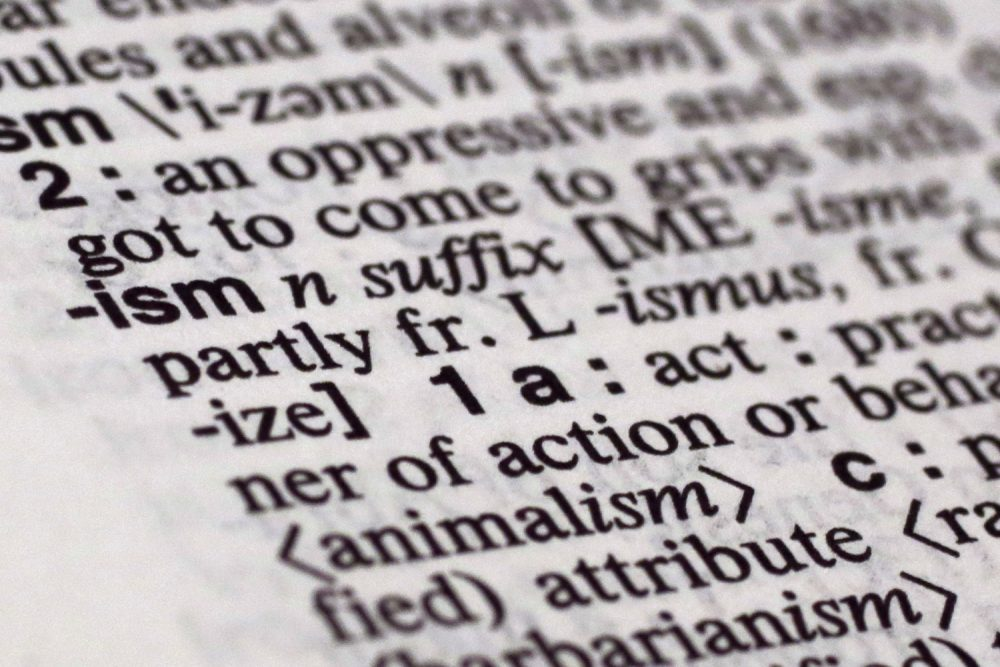 "The suffix ""ism"" is photographed in Merriam-Webster's Collegiate Dictionary, in New York,  Monday, Dec. 14, 2015.(Richard Drew/AP)"