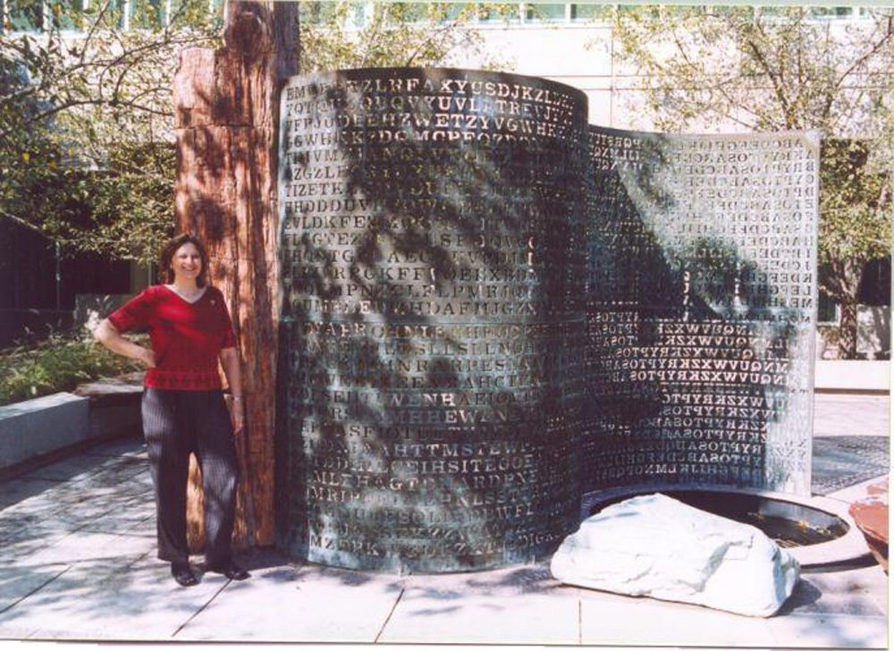 Elonka Dunin stands next to Kryptos in 2002, when she was allowed access to CIA's headquarters in Langley. (Courtesy of Elonka Dunin)