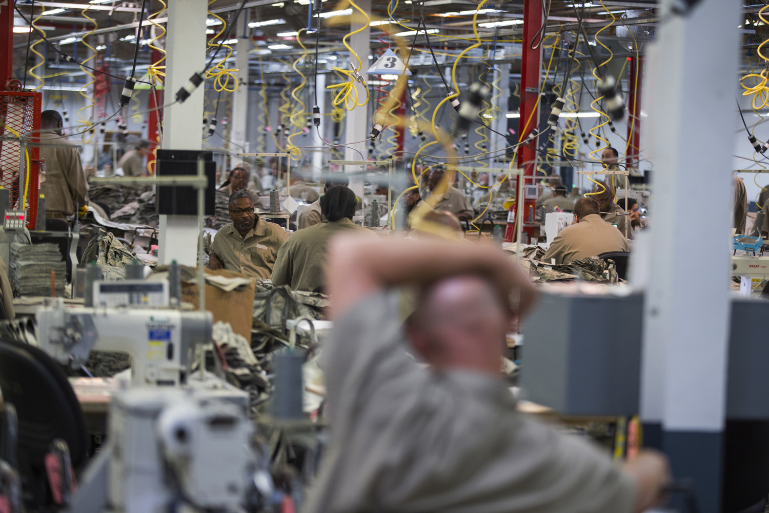 Inmates are seen at a factory in a federal prison in Alabama in April. Prisoners have been staging coordinated protests in several state prisons since earlier this month over a range of grievances, including pay raises and living conditions. )Evan Vucci/AP)