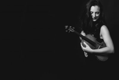 In this episode we speak with violinist Emily Stewart, pictured. (Courtesy)