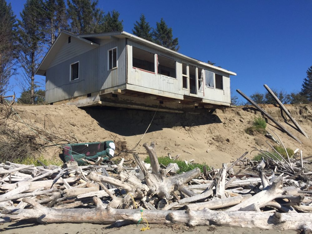 This will probably be the next in a long series of homes to fall into the sea at Washaway Beach, Washington. (Tom Banse/Northwest News Network)