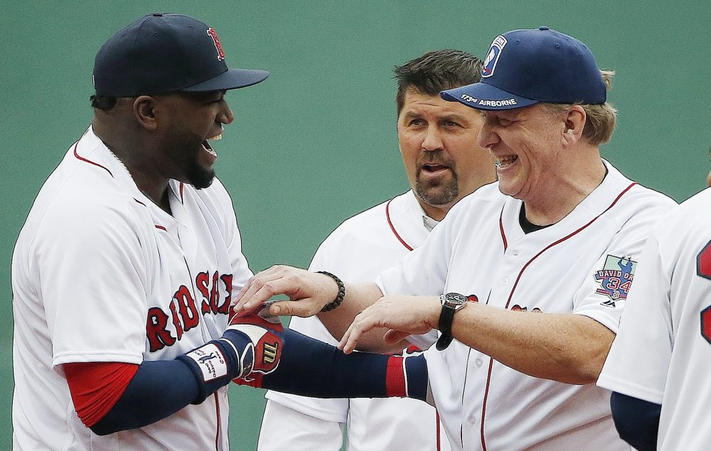 Boston Red Sox's David Ortiz, left, jokes with former teammates Curt Schilling, right, and Jason Varitek during a ceremony before a baseball game against the Toronto Blue Jays in Boston on Sunday. (Michael Dwyer/AP)
