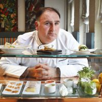 This March 15, 2011 photo shows chef José Andrés in his Minibar restaurant in Washington. Andres is quickly becoming the city's food ambassador to the rest of the country. (Jacquelyn Martin/AP)
