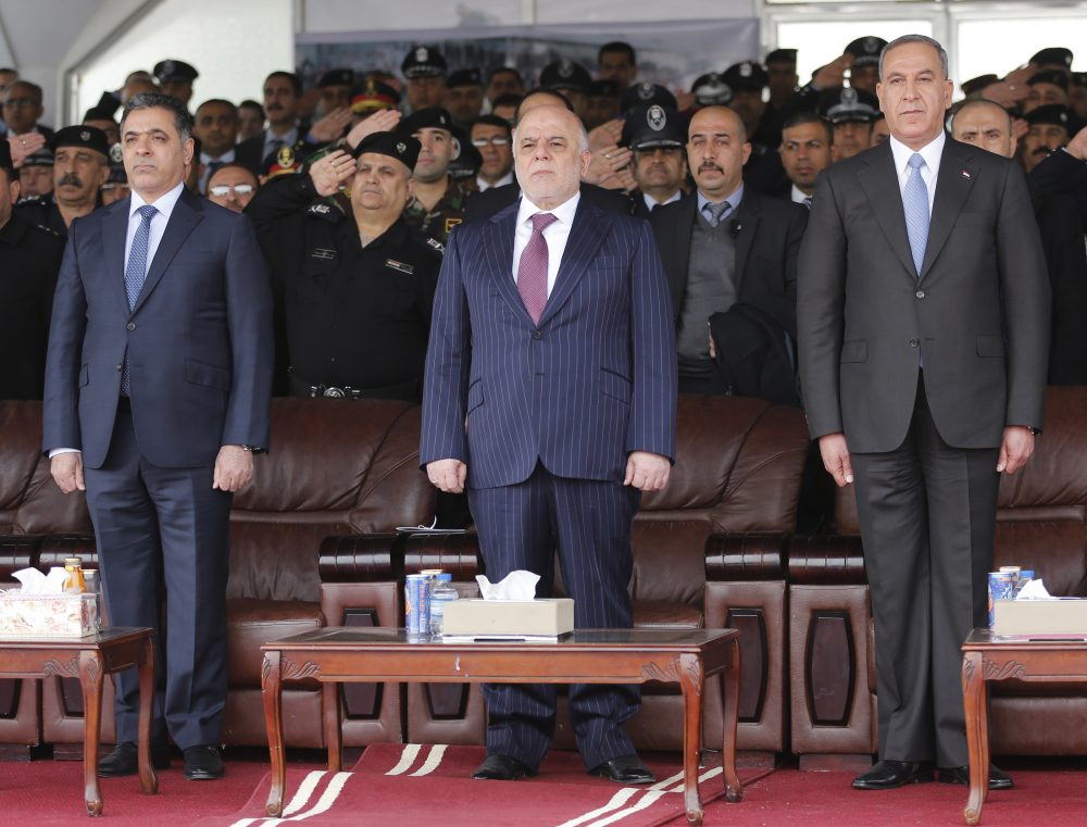 In this Jan. 9, 2016 file photo, Iraqi Prime Minister Haider al-Abadi, center, then Defense Minister Khaled al-Obeidi, right, and then Interior Minister Mohammed al-Ghabban, left, attend a ceremony marking Police Day, in Baghdad, Iraq. (Karim Kadim/AP)