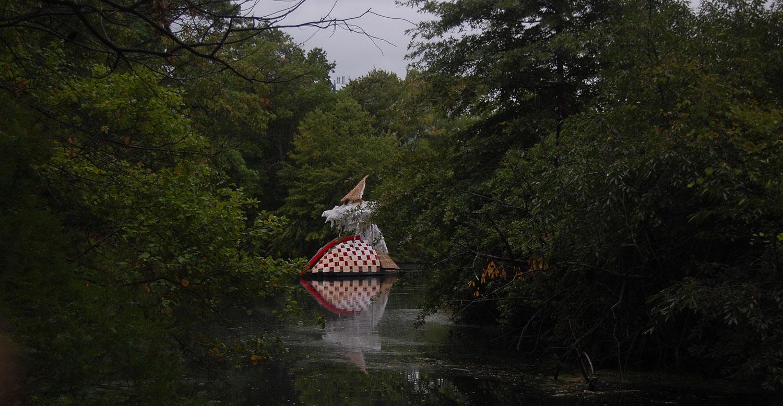 """Caoimhghin Ó Fraithile's """"South of Hy-Brasil"""" floats in Boston's Back Bay Fens. (Greg Cook/WBUR)"""