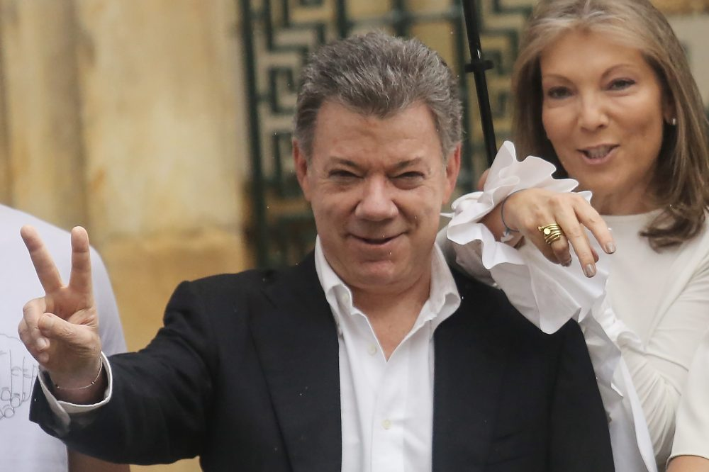 Colombia's President Juan Manuel Santos (center) makes the victory/peace sign with wife Maria Clemencia Rodriguez after voting in the referendum on a peace accord to end the 52-year-old guerrilla war between the FARC and the state on Oct. 2, 2016 in Bogota, Colombia. (Mario Tama/Getty Images)
