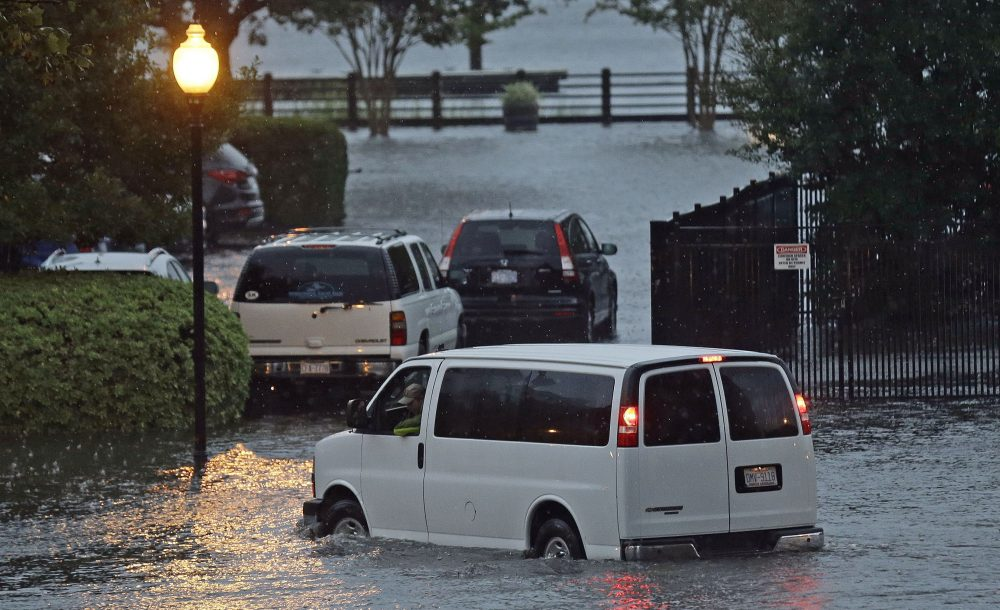 A driver creeps through rising water along Water Street beside the Cape Fear River in Wilmington, N.C., Saturday, Oct. 8, 2016 as Hurricane Matthew moves into the Carolinas. (Gerry Broome/AP)